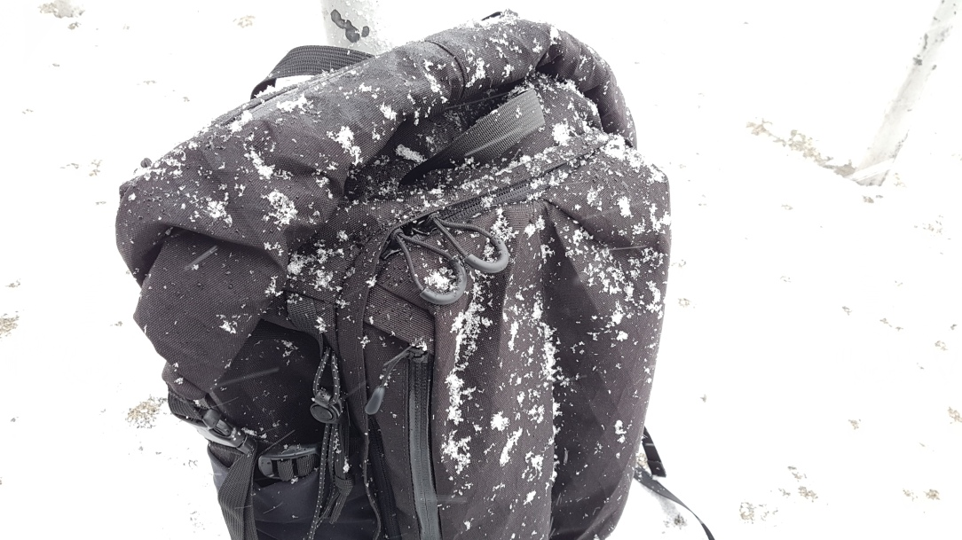 Remote Equipment Alpha 31 Backpack snow covered zipper pulls