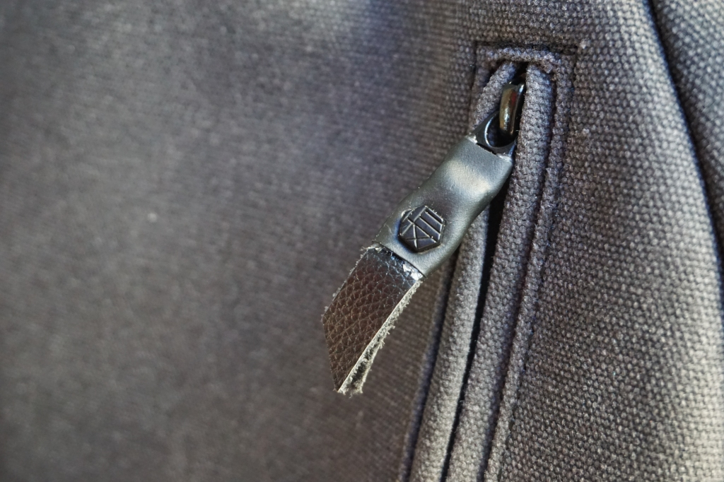 Hex brand supply signal backpack front pocket zipper logo detail view
