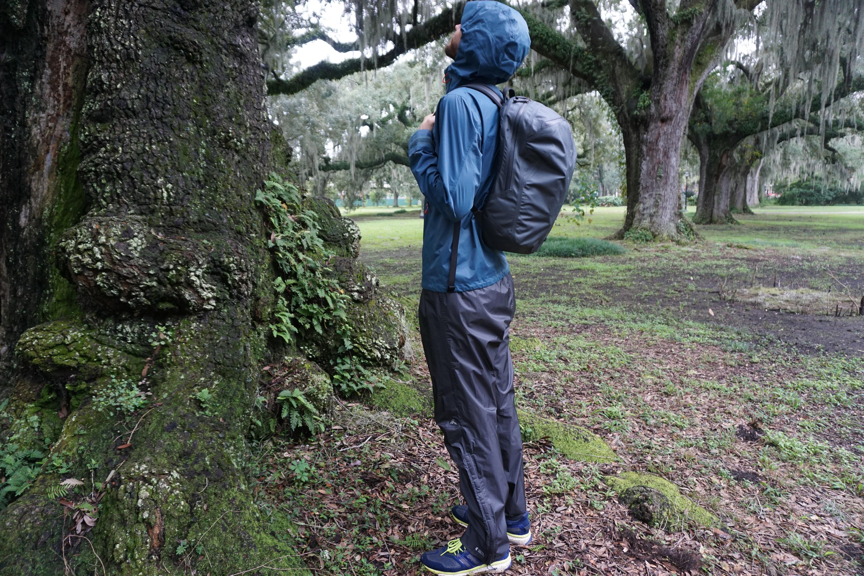 Arcteryx Granville Zip 16 backpack side view outdoors waterproof clothing hood up on body