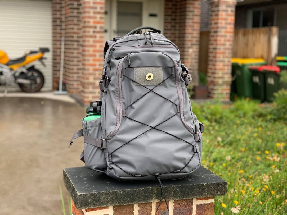 Alpha One Niner Evade 2.0 backpack review outside image with nalgene bottle