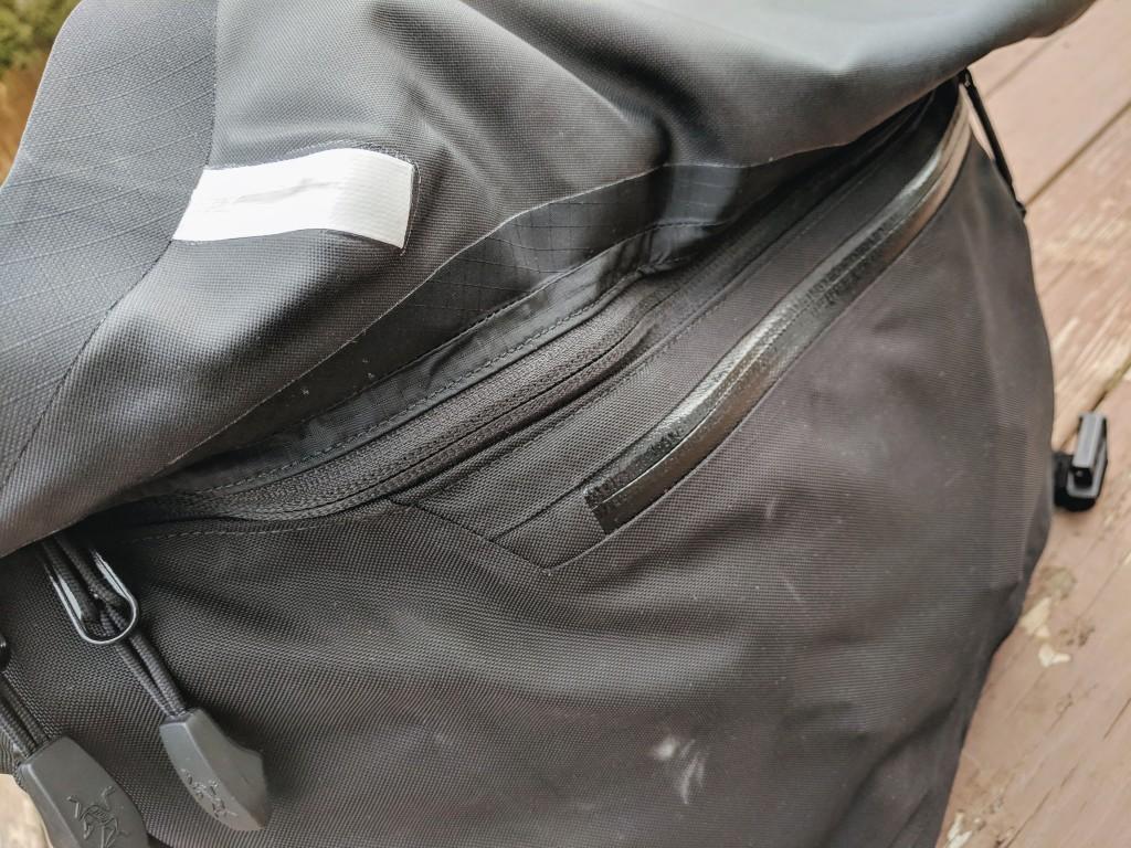 Arc'teryx LEAF Courier 15 messenger bag review main flap entry zipper closed exterior pocket view