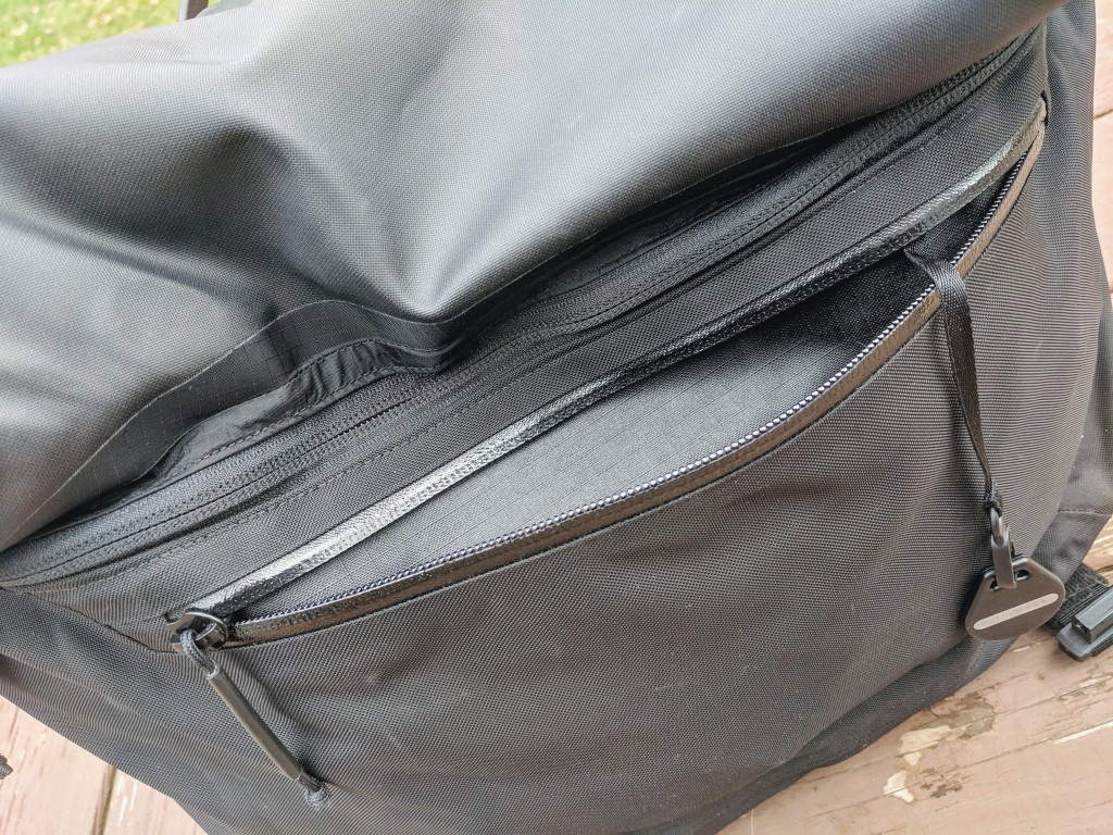 Arcteryx leaf courier 15 front zipper compartment organisation under flap view zip open